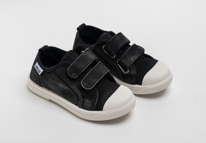 Distressed black canvas sneakers with double velcro straps. Chus Shoes.
