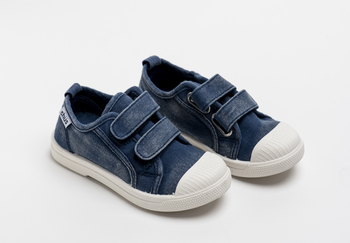 Distressed navy canvas sneakers with double velcro straps. Chus Shoes.