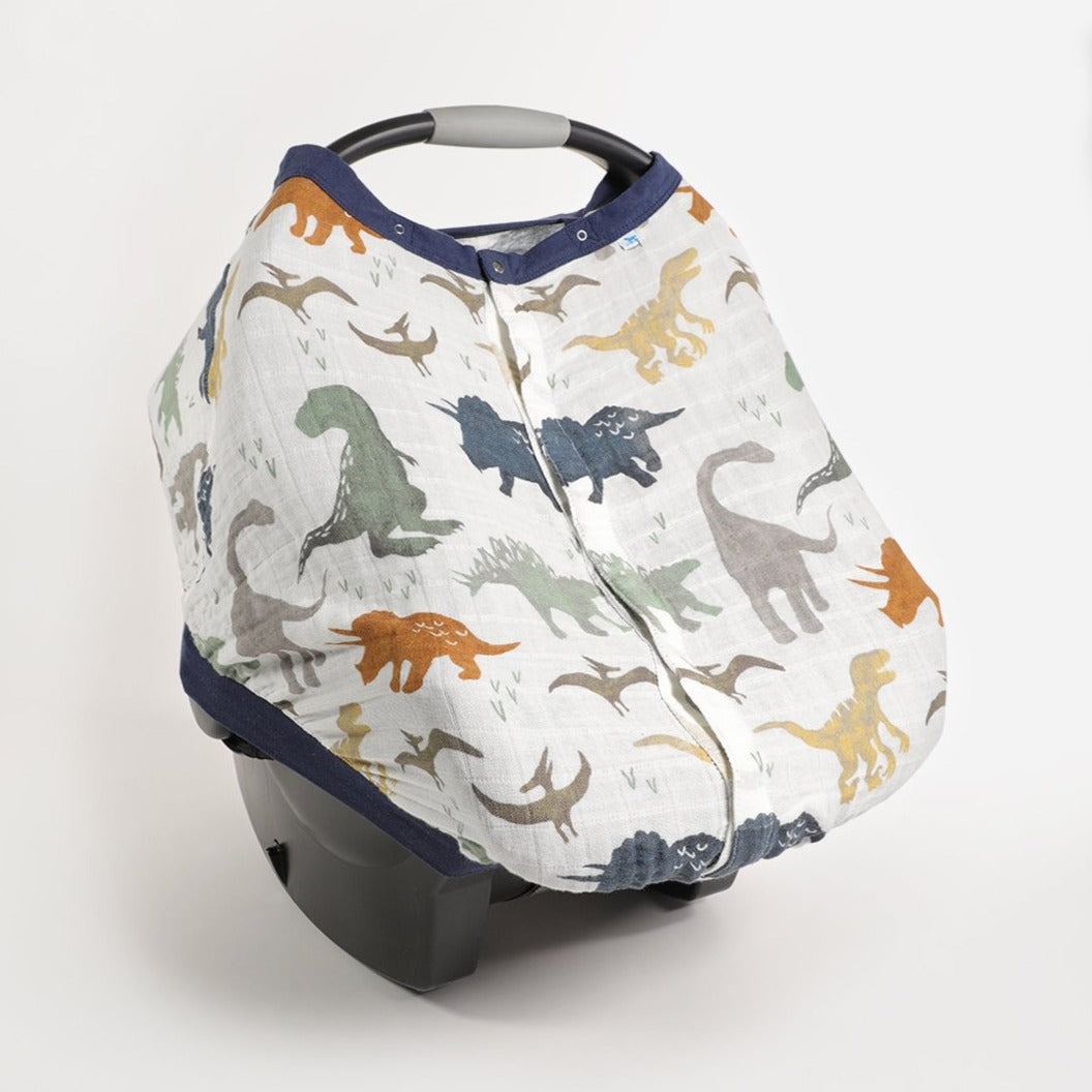 Little Unicorn Car Seat Canopy in Dino Friends print displays on car seat