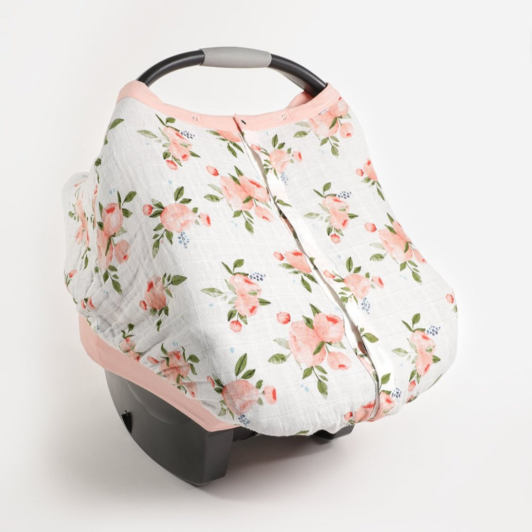 Little Unicorn Car Seat Canopy in Watercolor Roses print displayed on car seat
