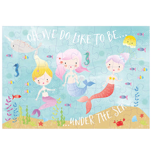 An under the sea mermaid scene 40 piece jigsaw puzzle in pastel colors with three mermaid friends, fish, seahorses, narwhals and other sea creatures.