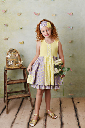 Super soft butter yellow knit dress with purple dot accents. Biker shorts included and well as matching headband. On model.