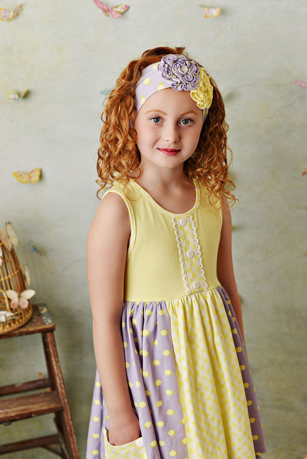 Super soft butter yellow knit dress with purple dot accents. Biker shorts included and well as matching headband.