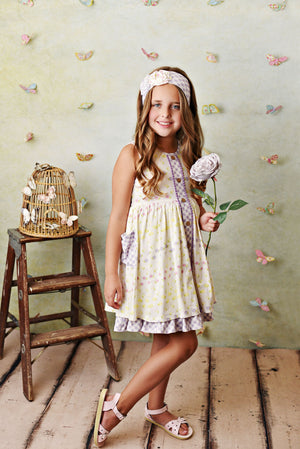 Butter yellow and lavender pocket dress with buttons up front and ruffle trim. Comes with matching headband and shorties.