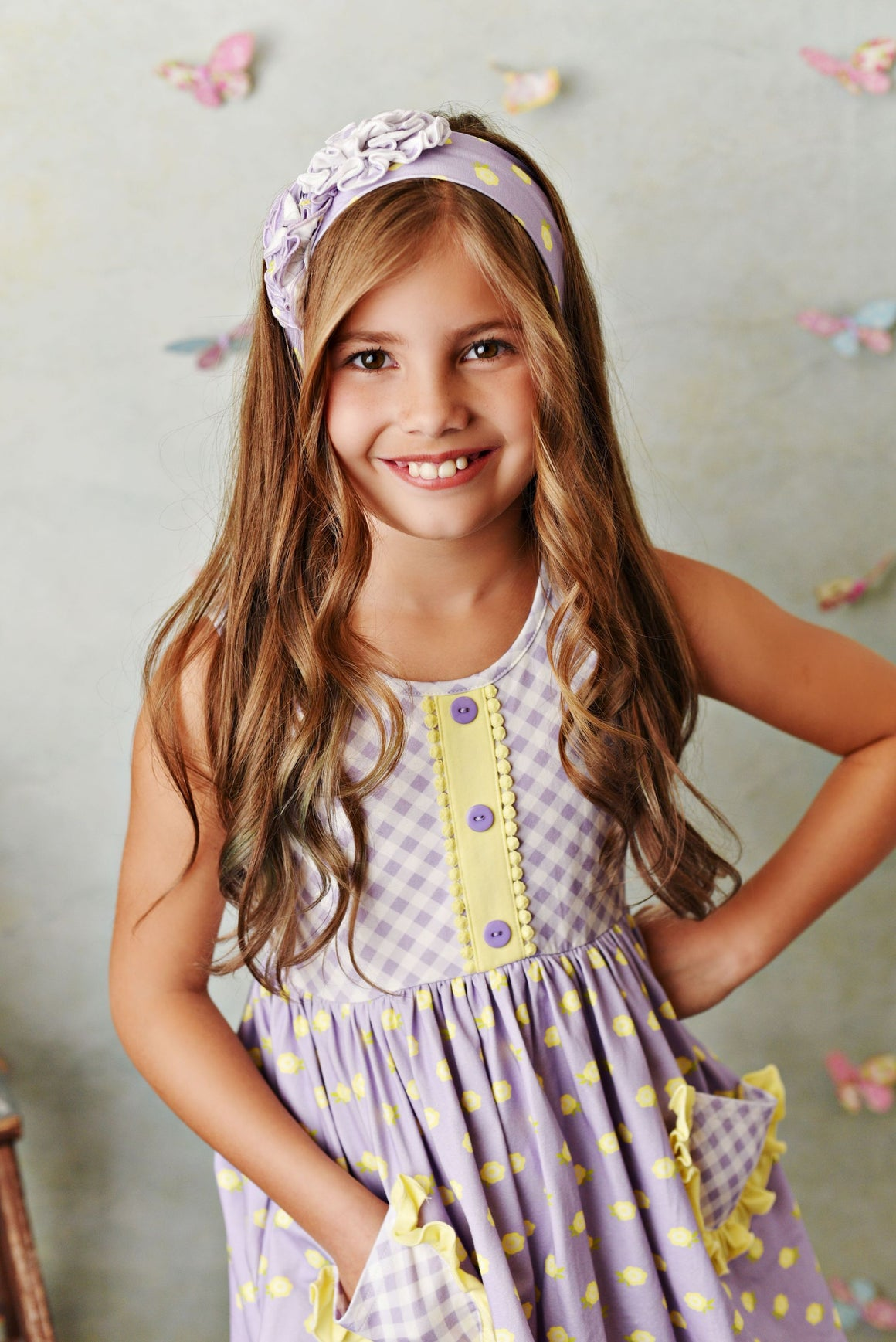 Lavender gingham and lemon yellow dot ruffle pocket tunic top with ruffle shorties. Soft knit fabric. Comes with matching headband.