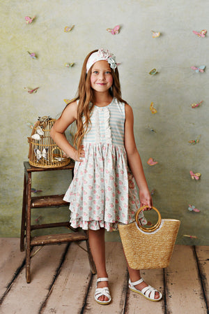 Sweet pale blue and cream stripe knit dress with pink rose floral fabric; double deep ruffle pockets, matching shorties and headband. On model.