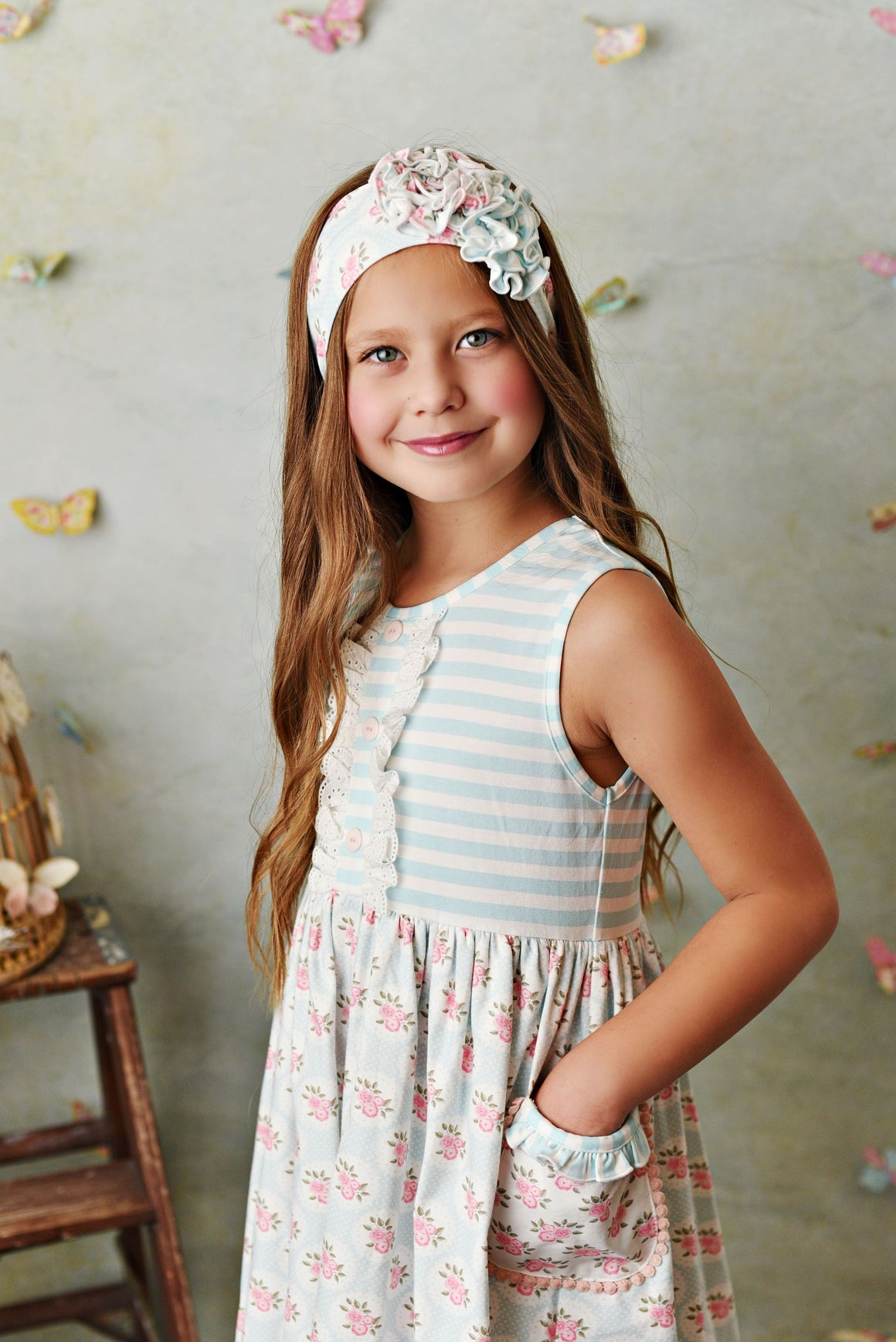 Sweet pale blue and cream stripe knit dress with pink rose floral fabric; double deep ruffle pockets, matching shorties and headband.