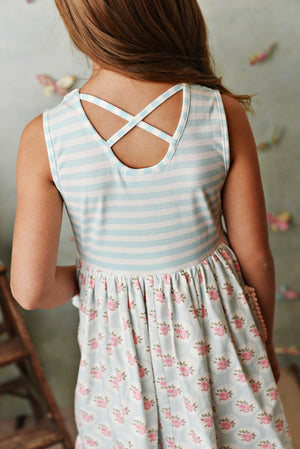 Sweet pale blue and cream stripe knit dress with pink rose floral fabric; double deep ruffle pockets, matching shorties and headband. Back view.