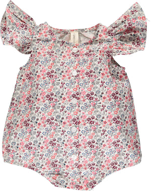 100% cotton flutter sleeve baby bubble in red and pink floral print. Buttons up front. Elastic legs and snaps at crotch. For baby girl. By Vignette.