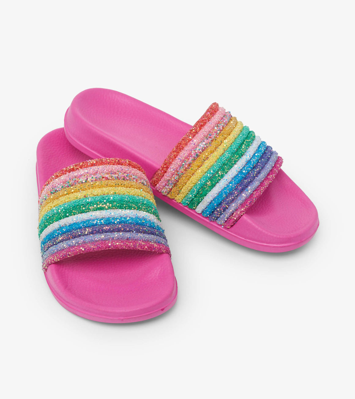 Girls easy on off slide on sandals in hot pink with glittery rainbow upper.