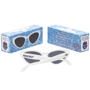 "Cat eye shaped baby and toddler sunglasses -- in ""wicked white"". 100% UVA and UVB protection. Babiators. Packaging"