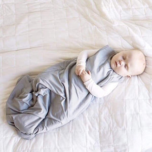 1.0 TOG bamboo super soft infant sleep sack in storm grey. From Kyte Baby. Baby boy model.