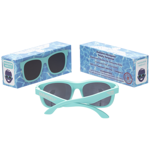 "Original navigator baby and toddler sunglasses in ""totally turquoise"". 100% UVA and UVB protection. Babiators. Packaging."