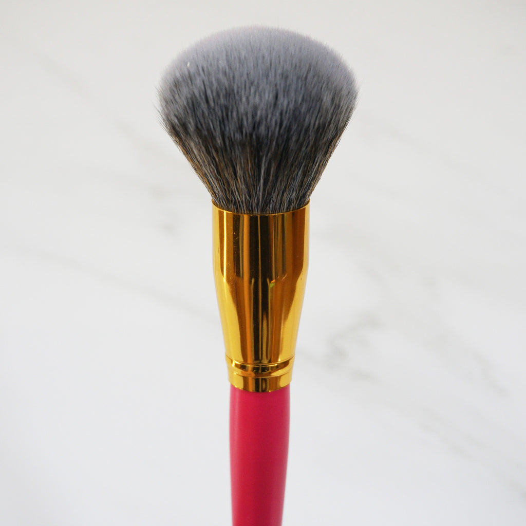 The Face Makeup Brush Glossary. Tapered Foundation Brush: Loosely packed bristles make for one big, fluffy brush with a rounded shape. Use it with loose or pressed powders, just tap off the excess before using sweeping motions to brush it across the face. And apply over a sink. This brush is good but loose powder can still get a bit messy.