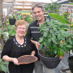 Dave with local coffee grower at Sage Garden