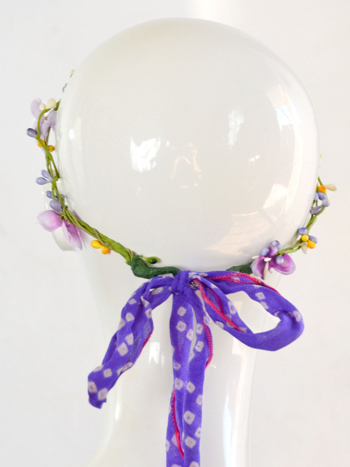 purple, green, and yellow floral wedding tiara