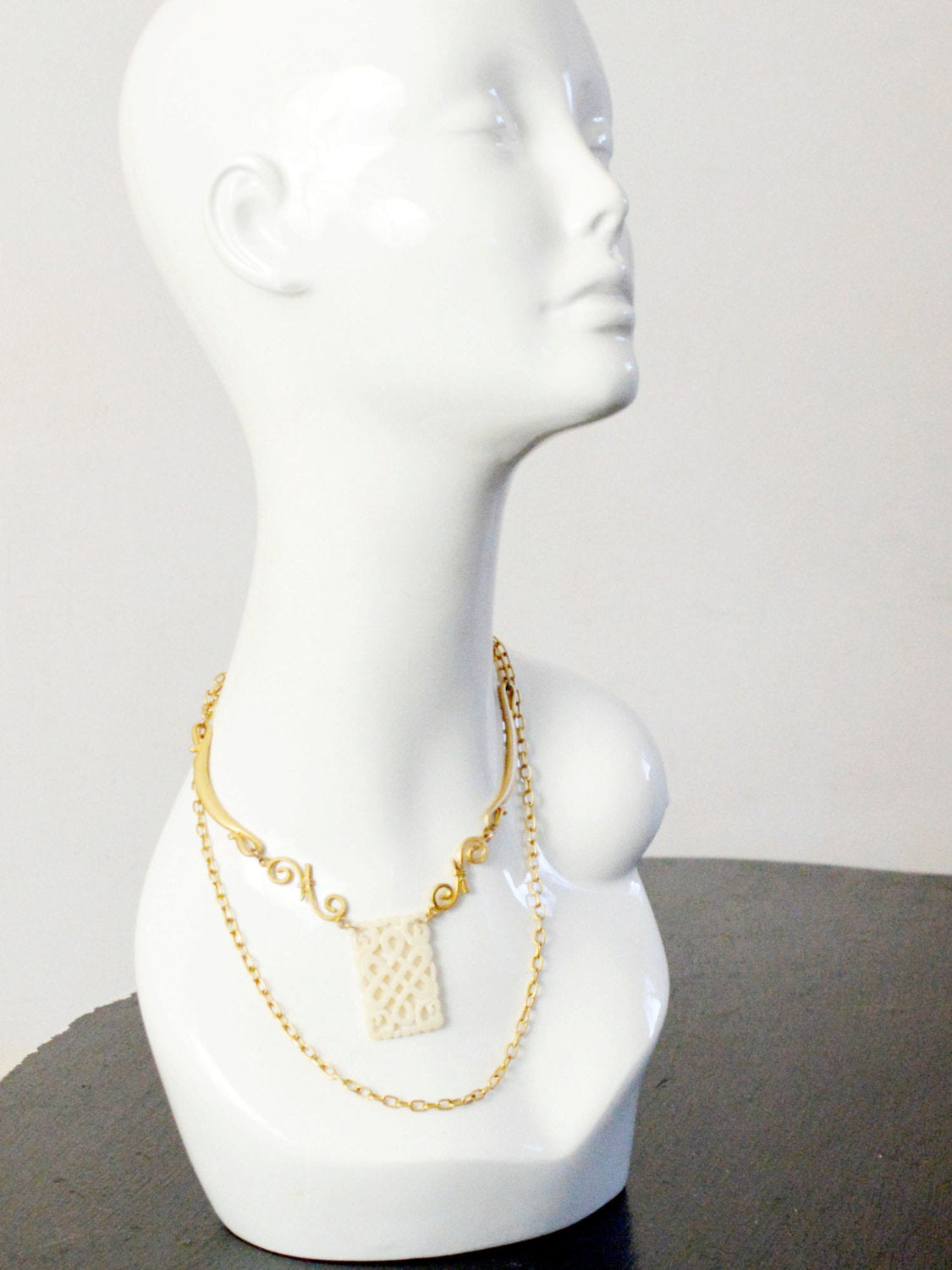long gold wrap necklace with bone amulet for weddings