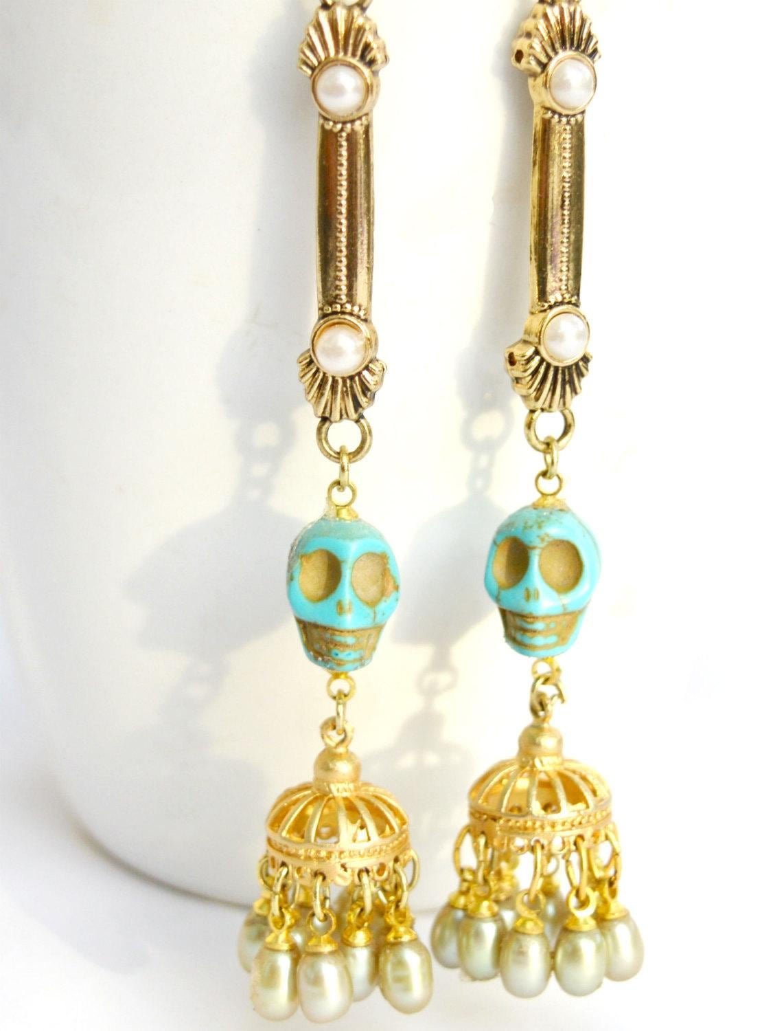 gold chandelier earrings with skulls and pearls for alternative brides