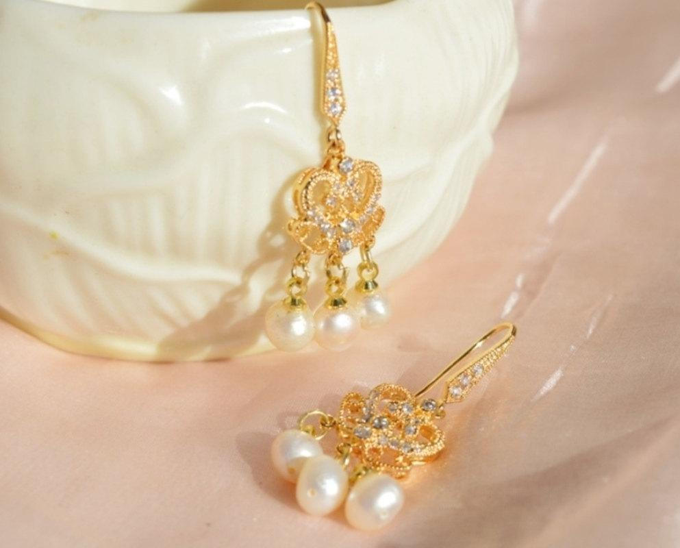 gold dangle earrings with pearls