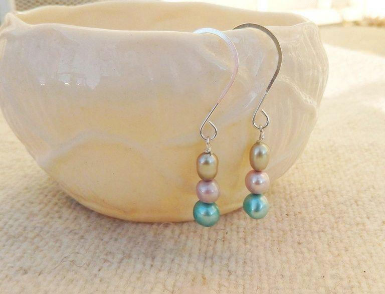 pearl drop wedding earrings in silver, pink, green, and blue