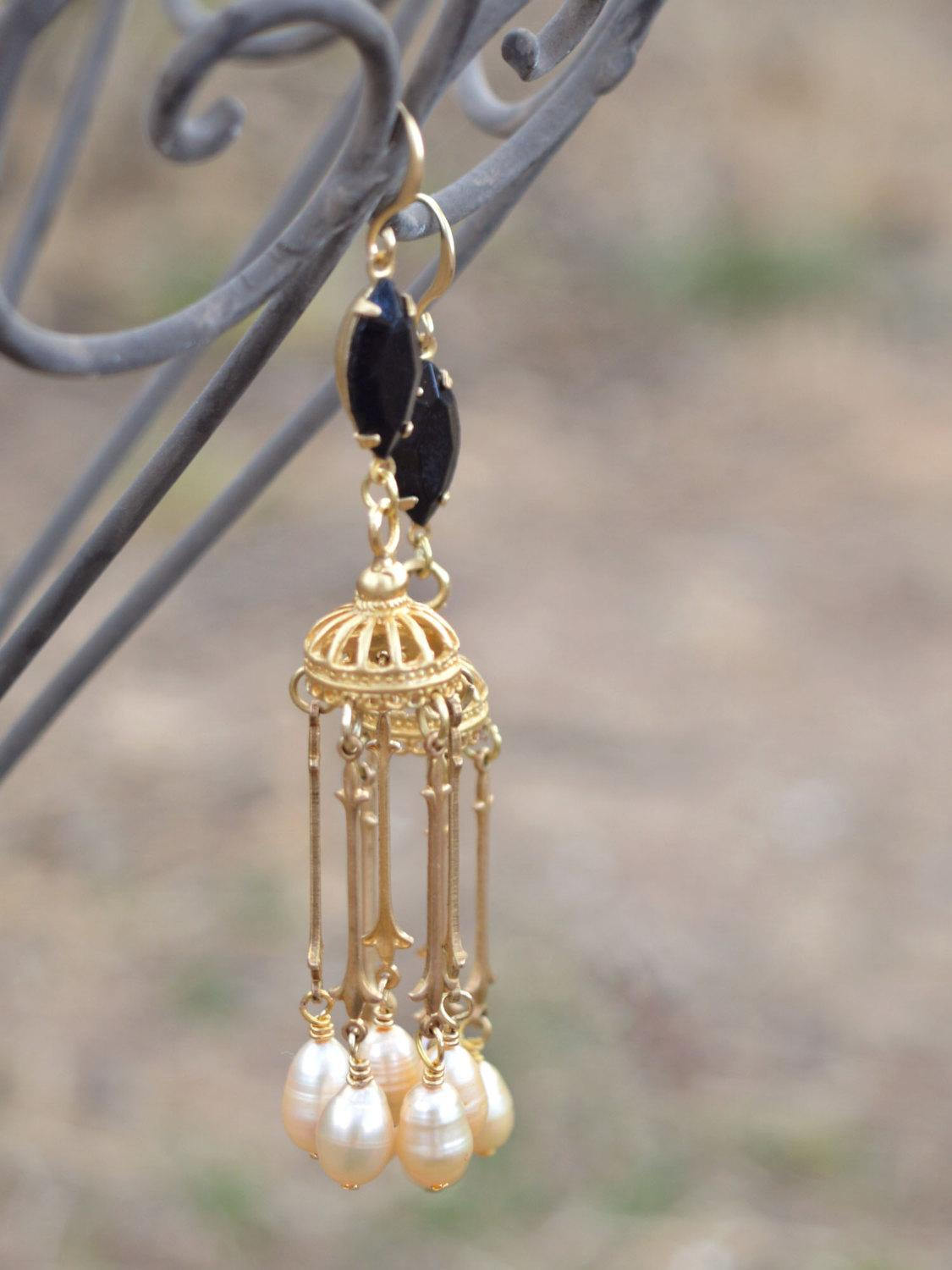 Elegant gold drop earrings with pearls and crystals.