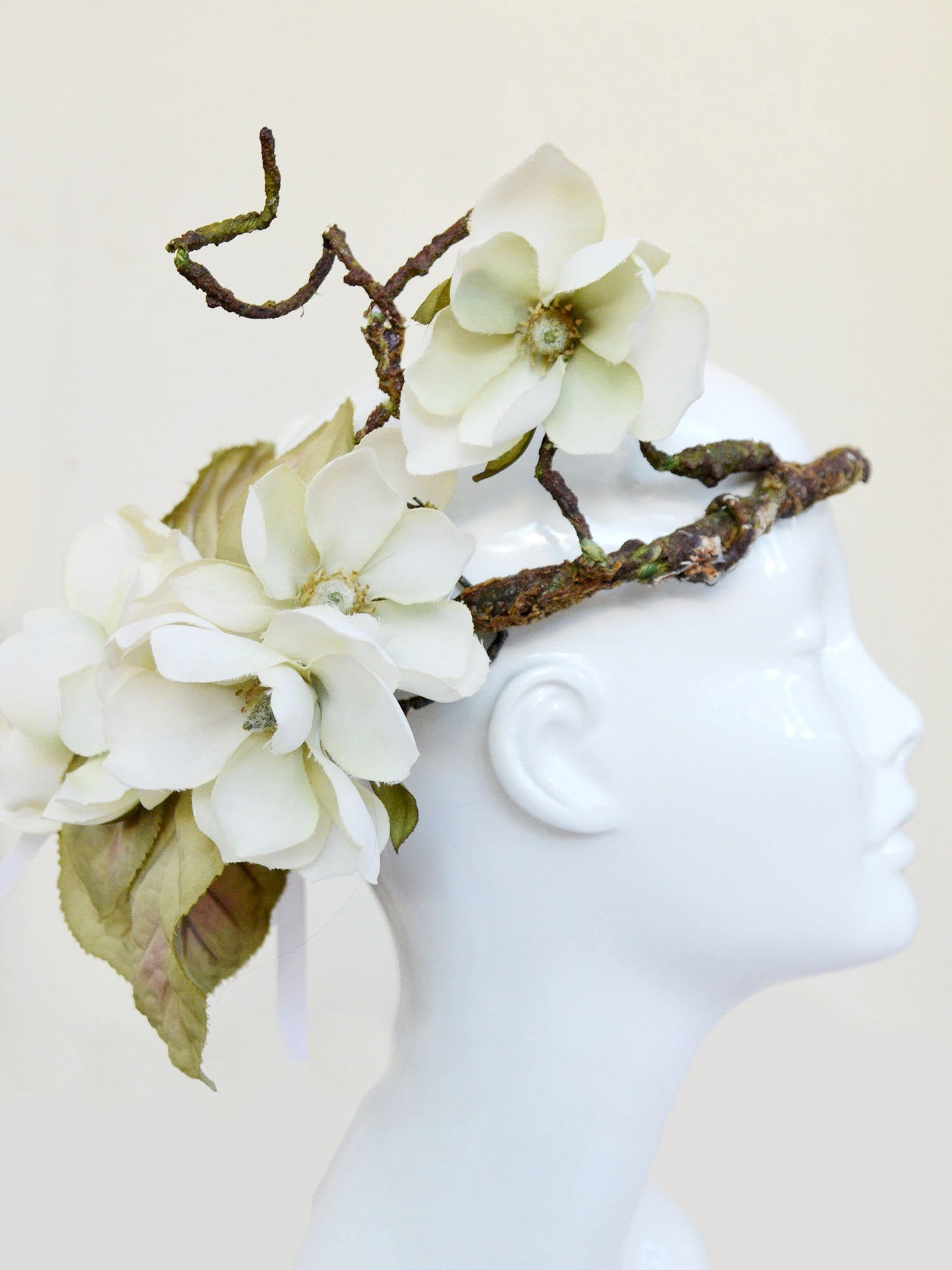 white, green, and brown magnolia wedding crown