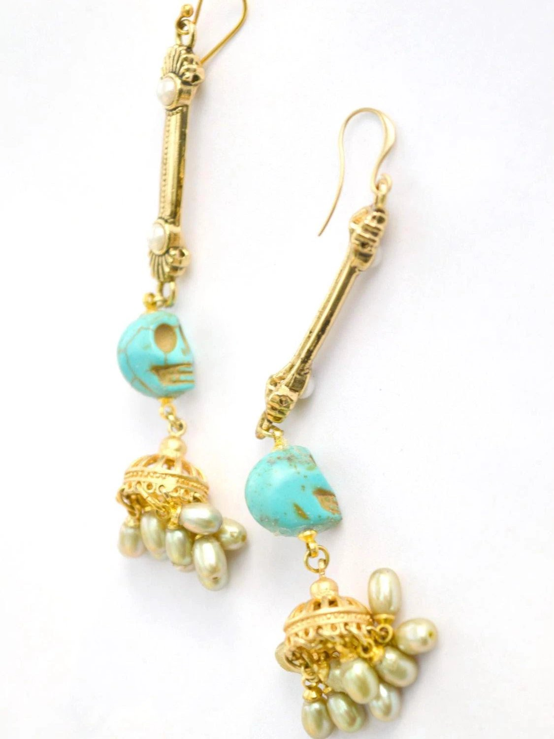 long gold drop earrings with turquoise skulls and green freshwater pearls