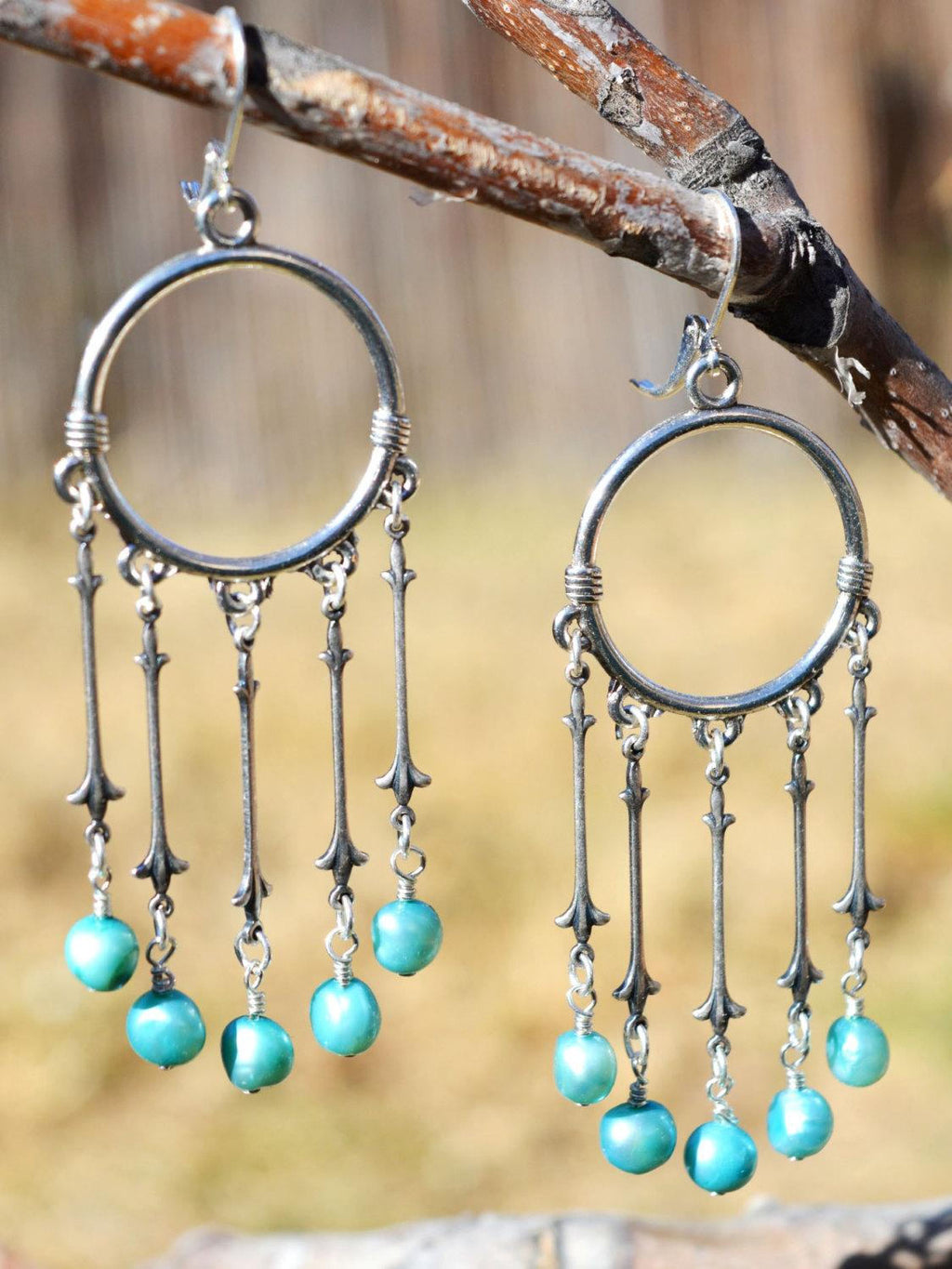 silver hoop earrings with blue freshwater pearls