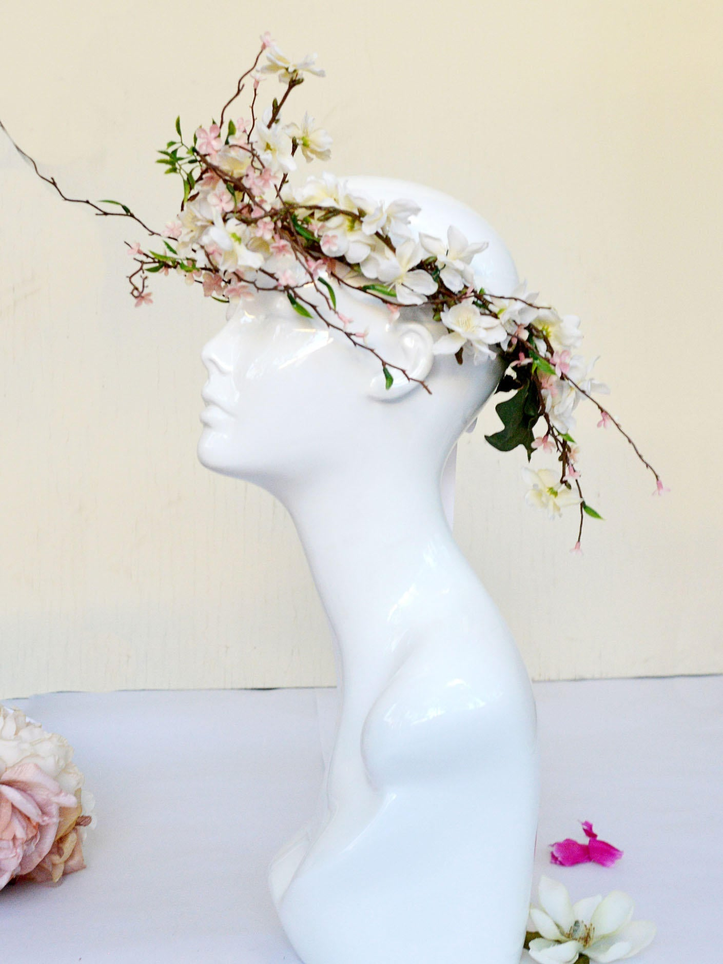 Floral wedding bridal crown of cherry blossoms, branches, flowers.
