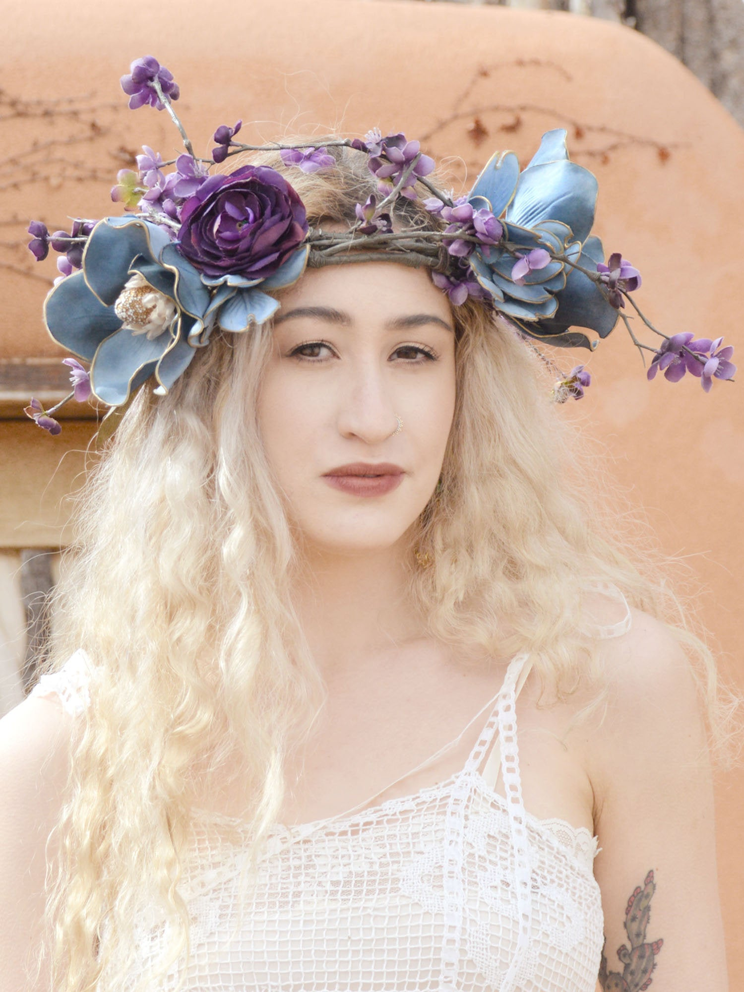 blonde bride wearing purple and blue flower wreath