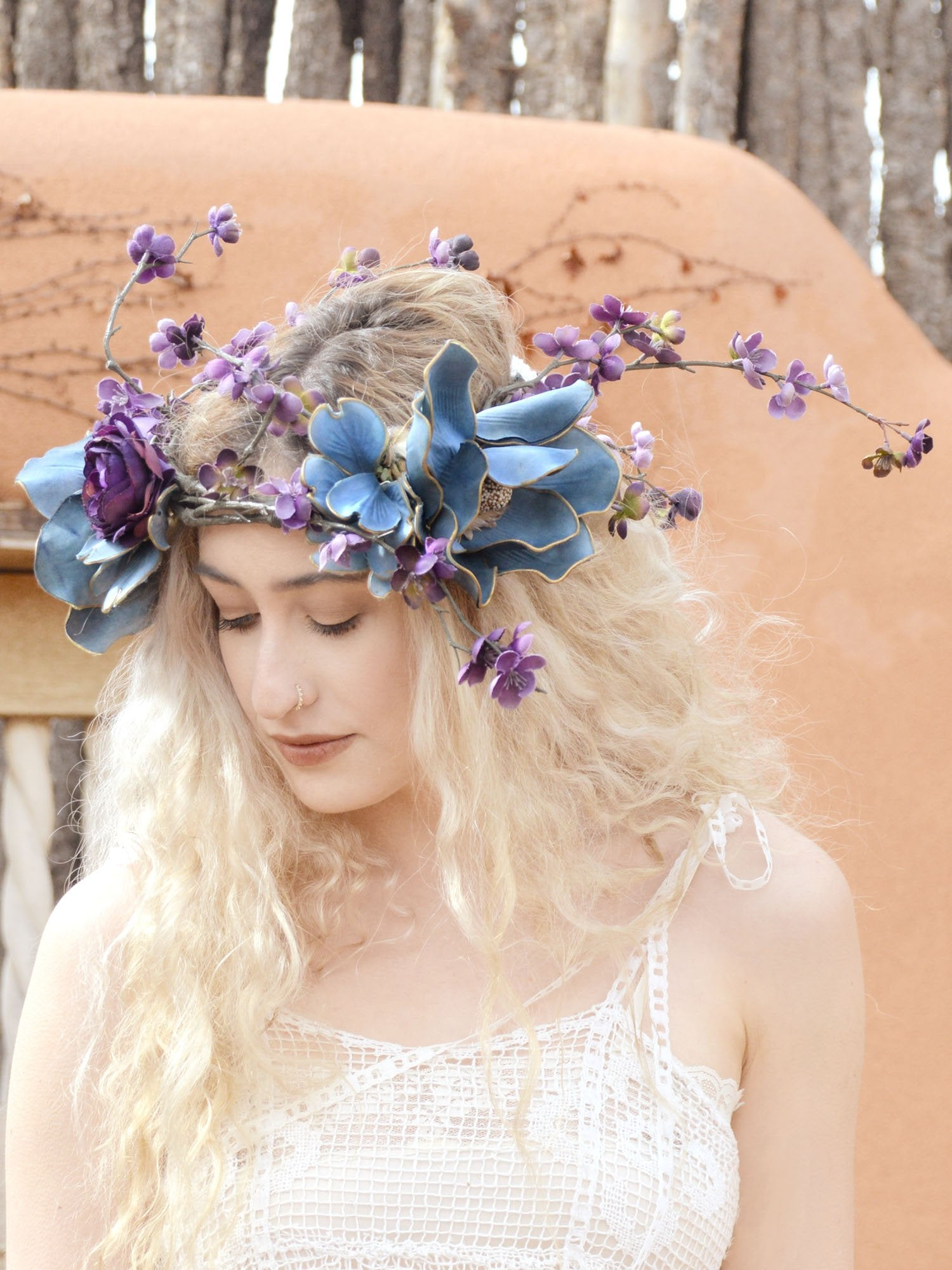 beautiful blonde bride in purple and blue floral crown