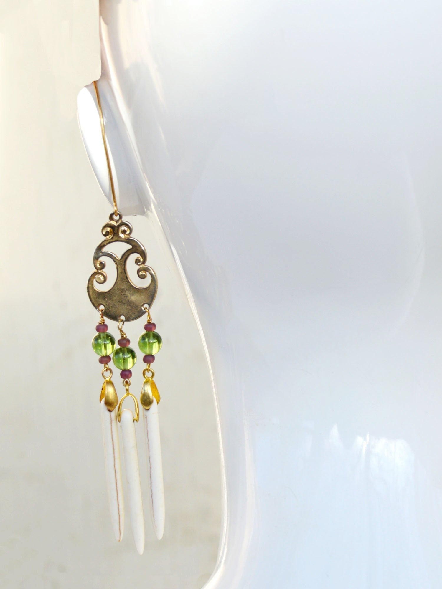wedding earrings in green, gold, and white