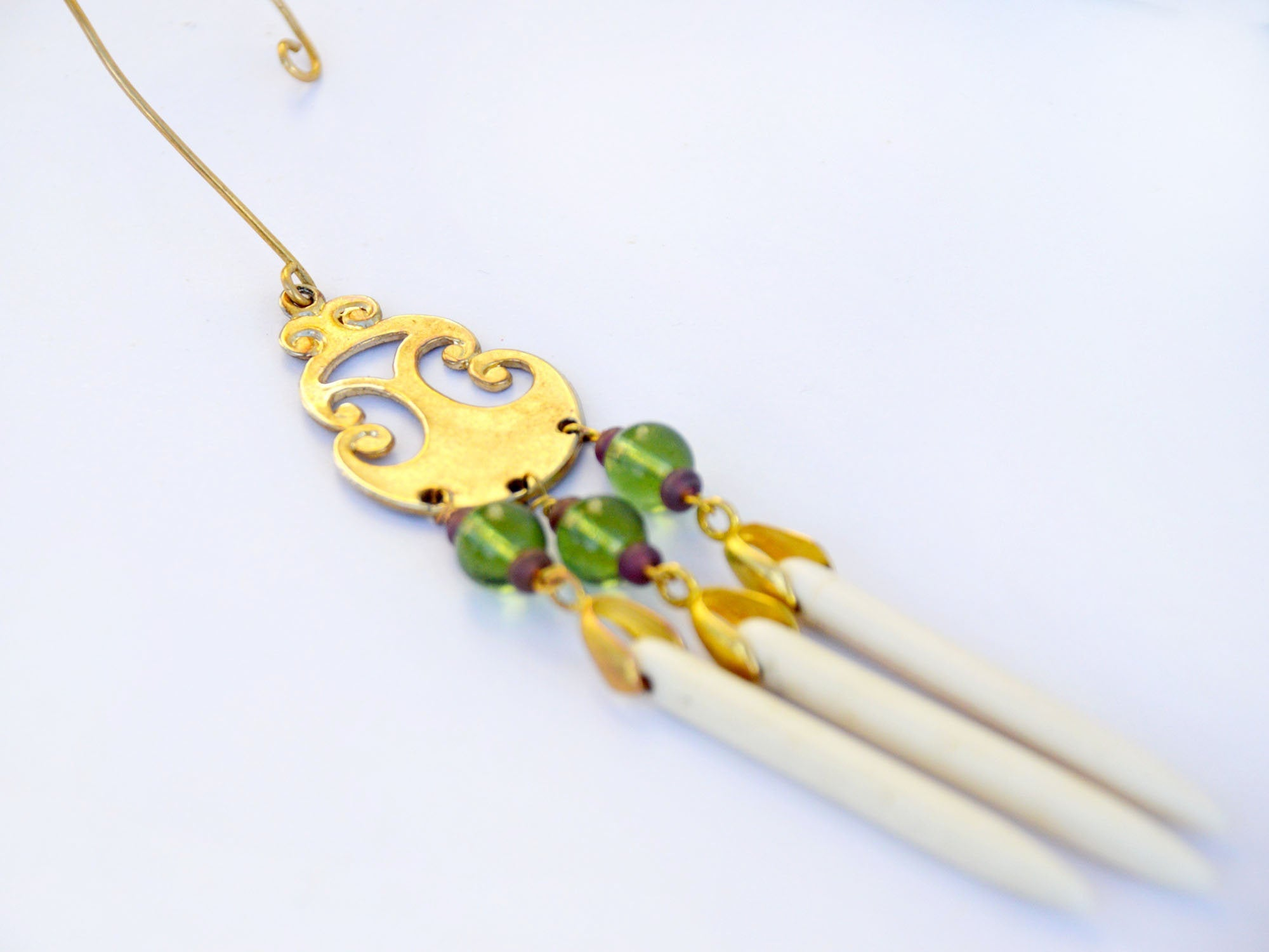 ear wrap with peridot beads, howlite daggers, and gold