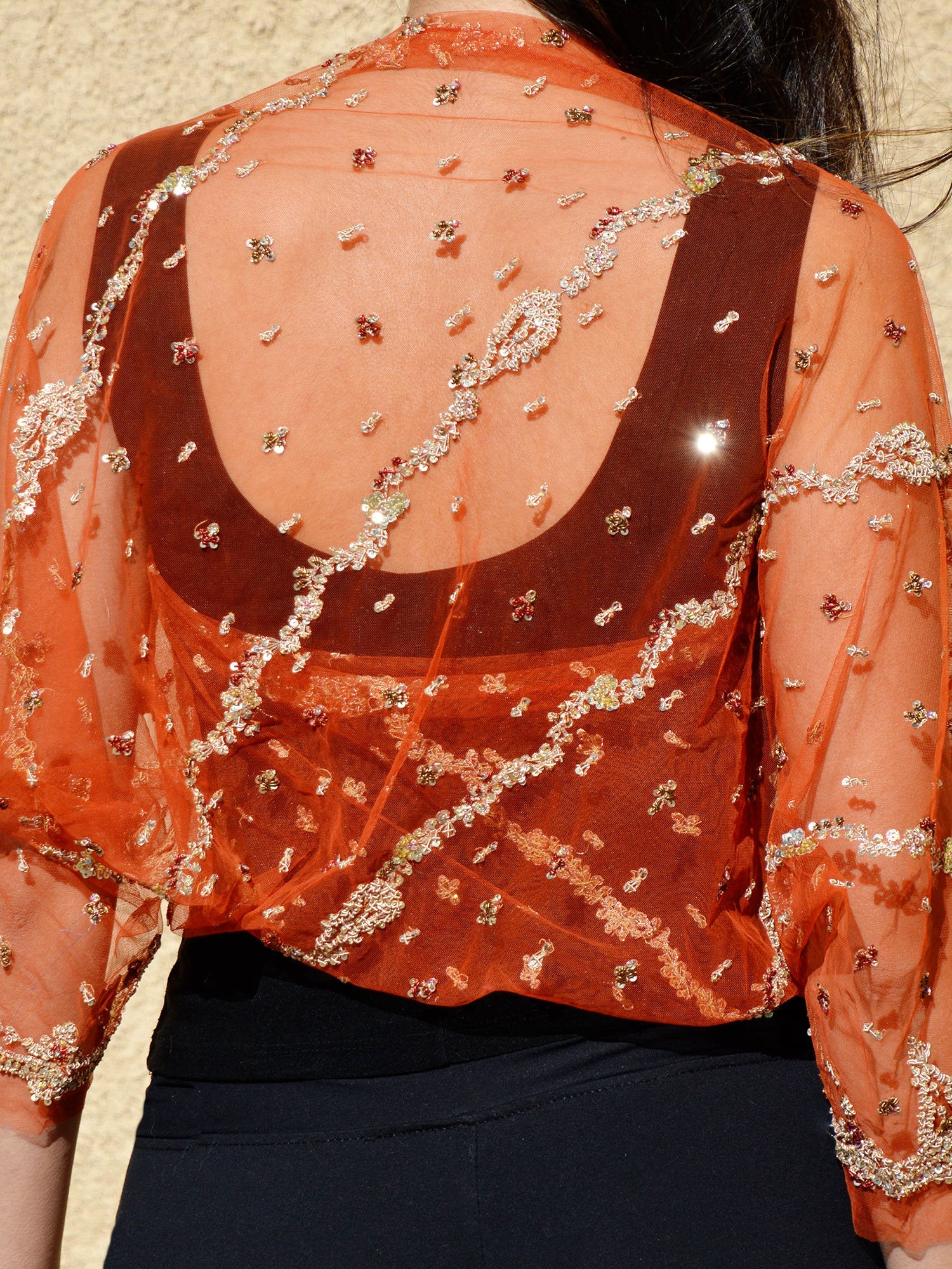 beaded orange and gold shrug
