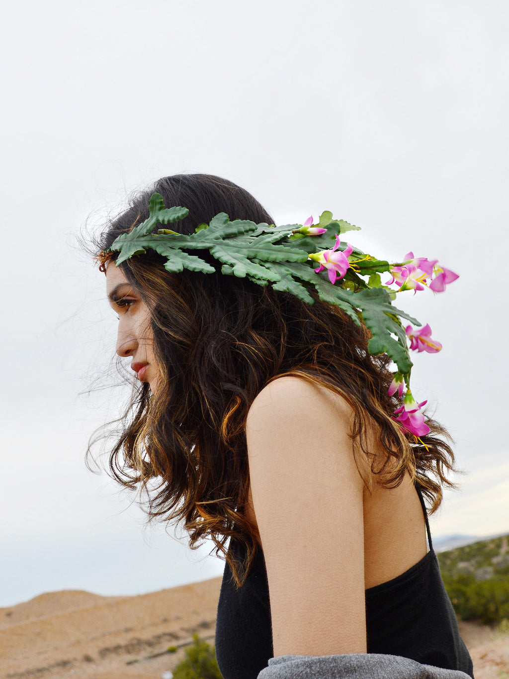 Brunette model in green and pink christmas cactus flower crown.