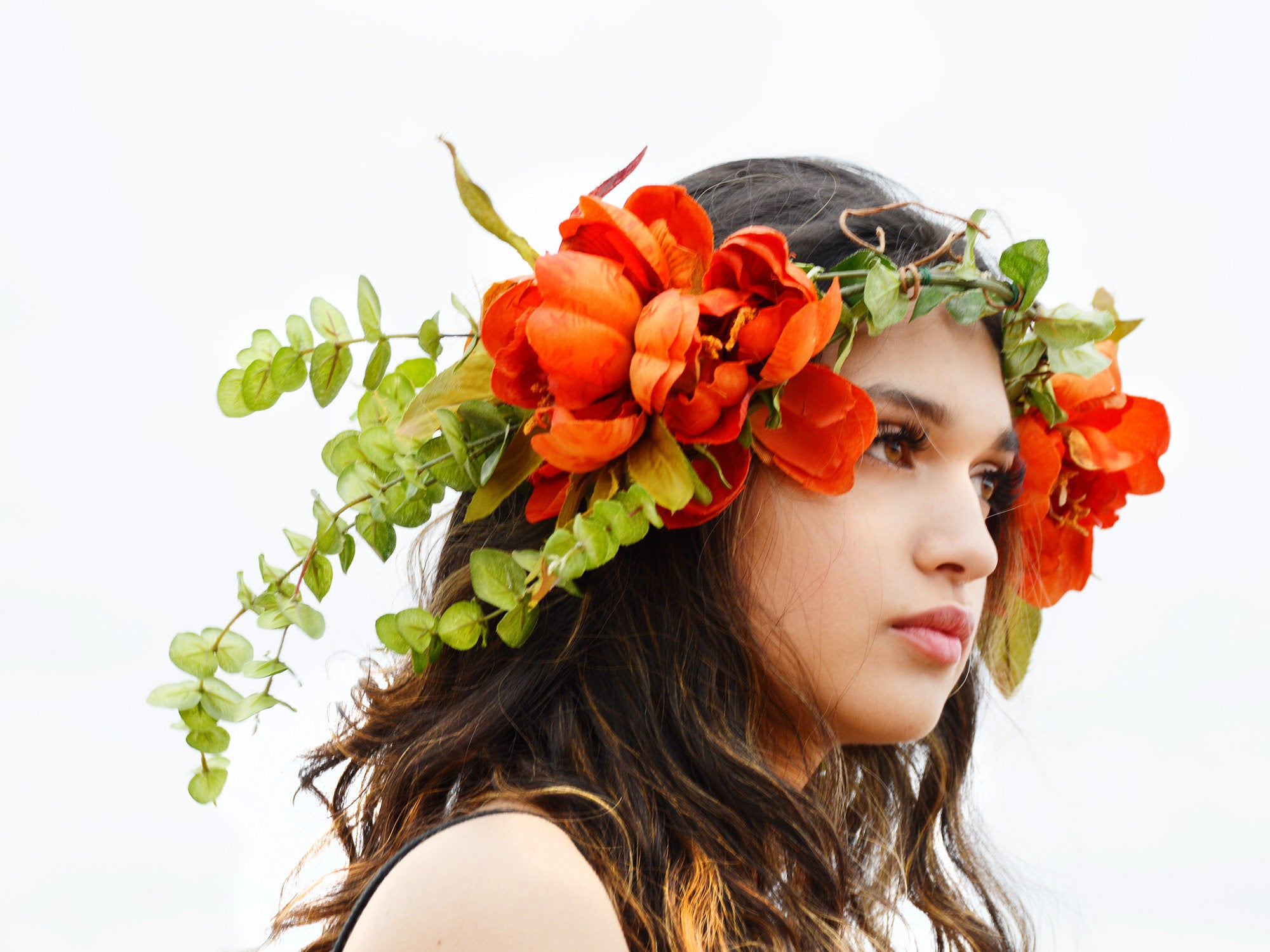 dramatic wedding head piece in orange and green