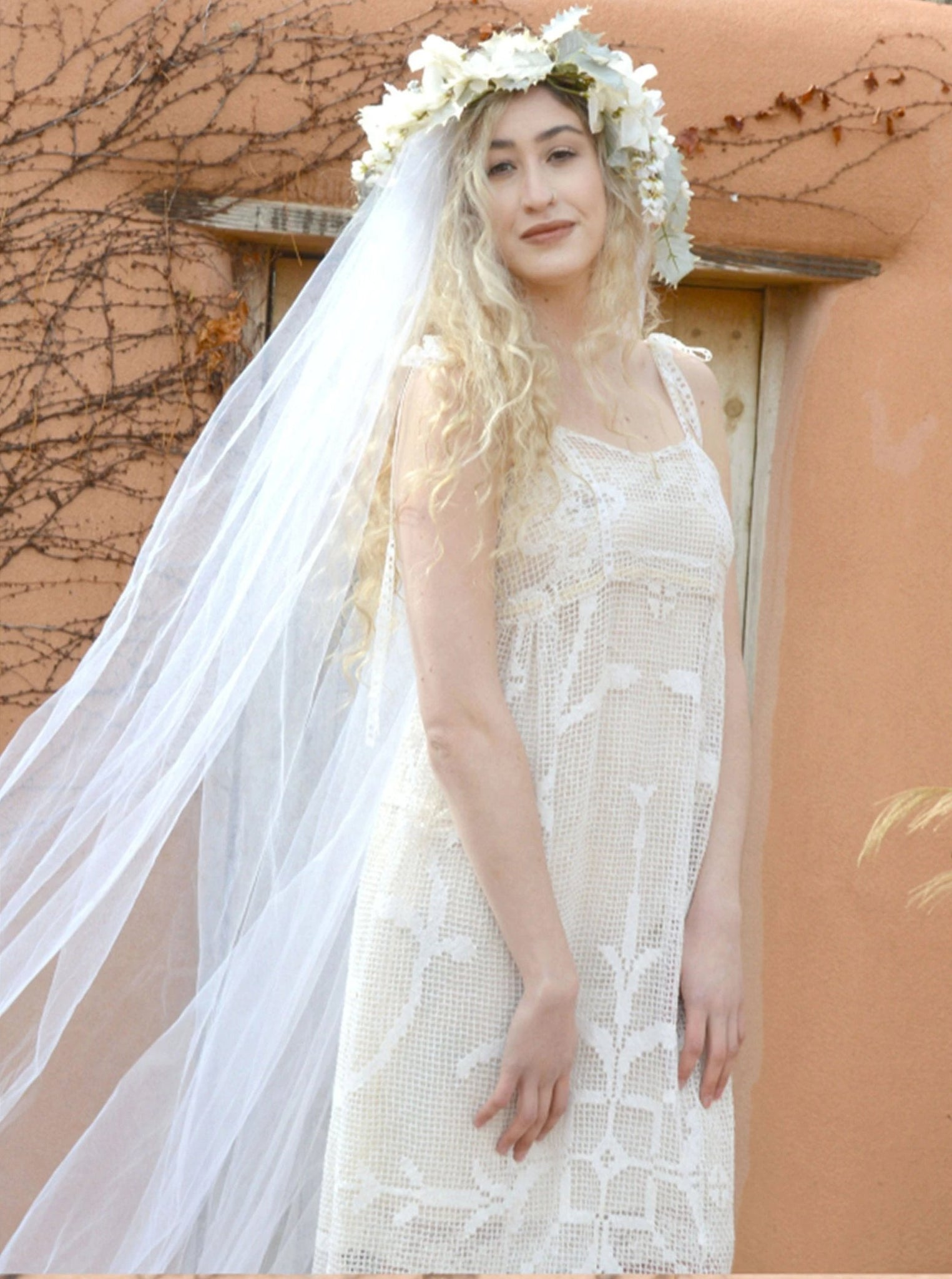 Blonde bride in long crochet lace empire waist wedding gown.