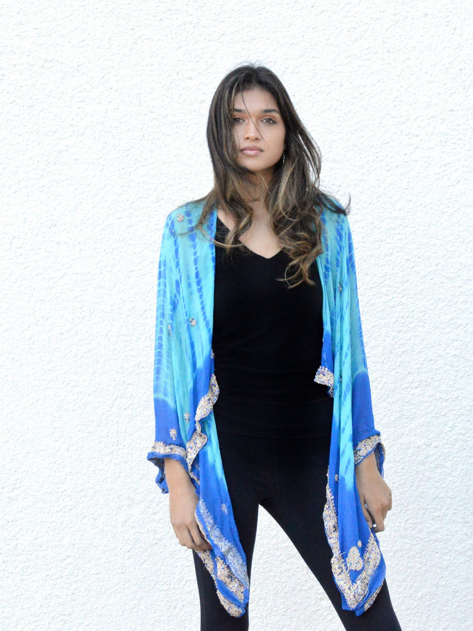 Model wearing light and dark blue silk chiffon kimono jacket with silver embroidery.