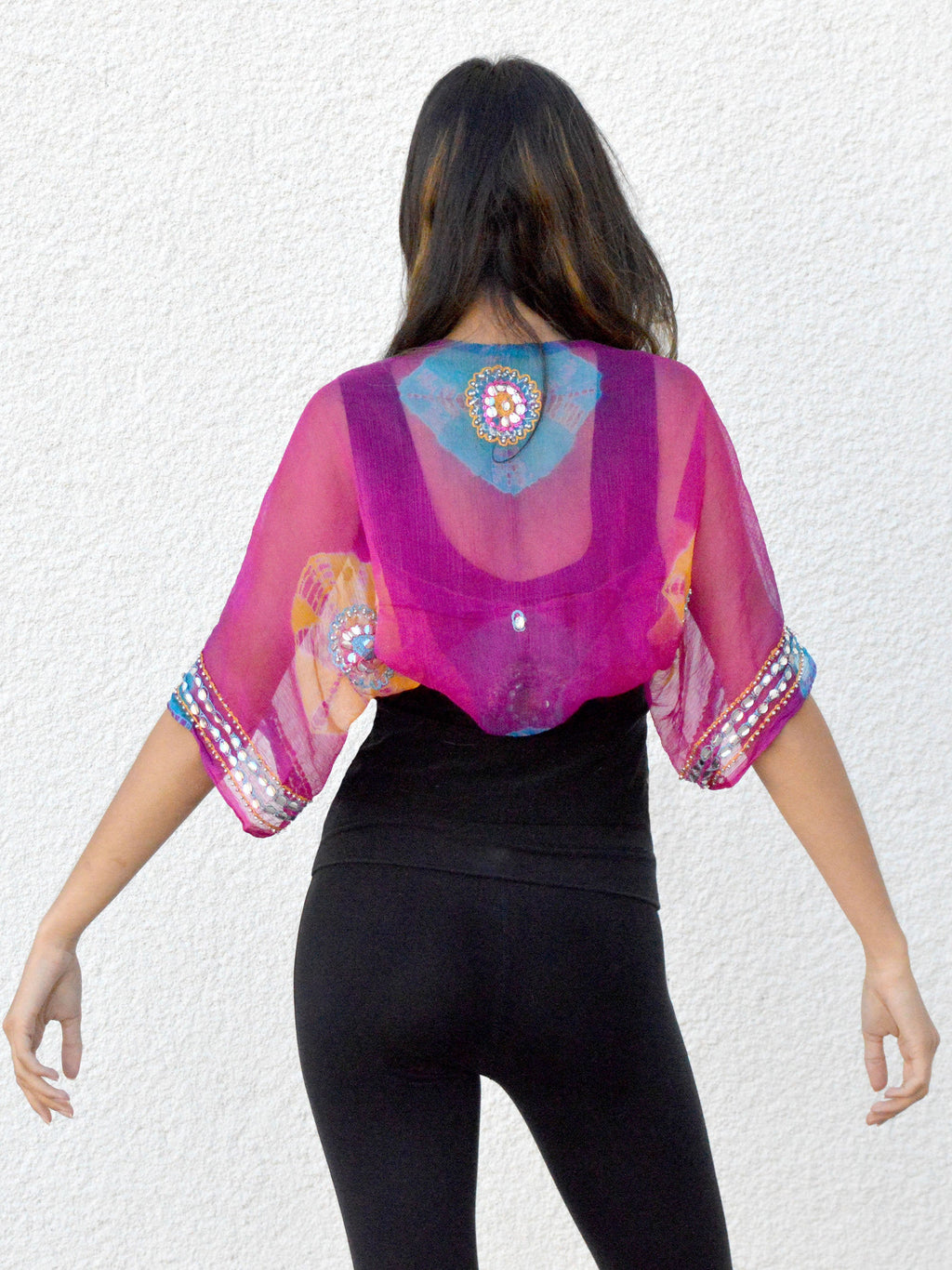 back view of pink, blue, gold, and silver silk chiffon wedding shrug