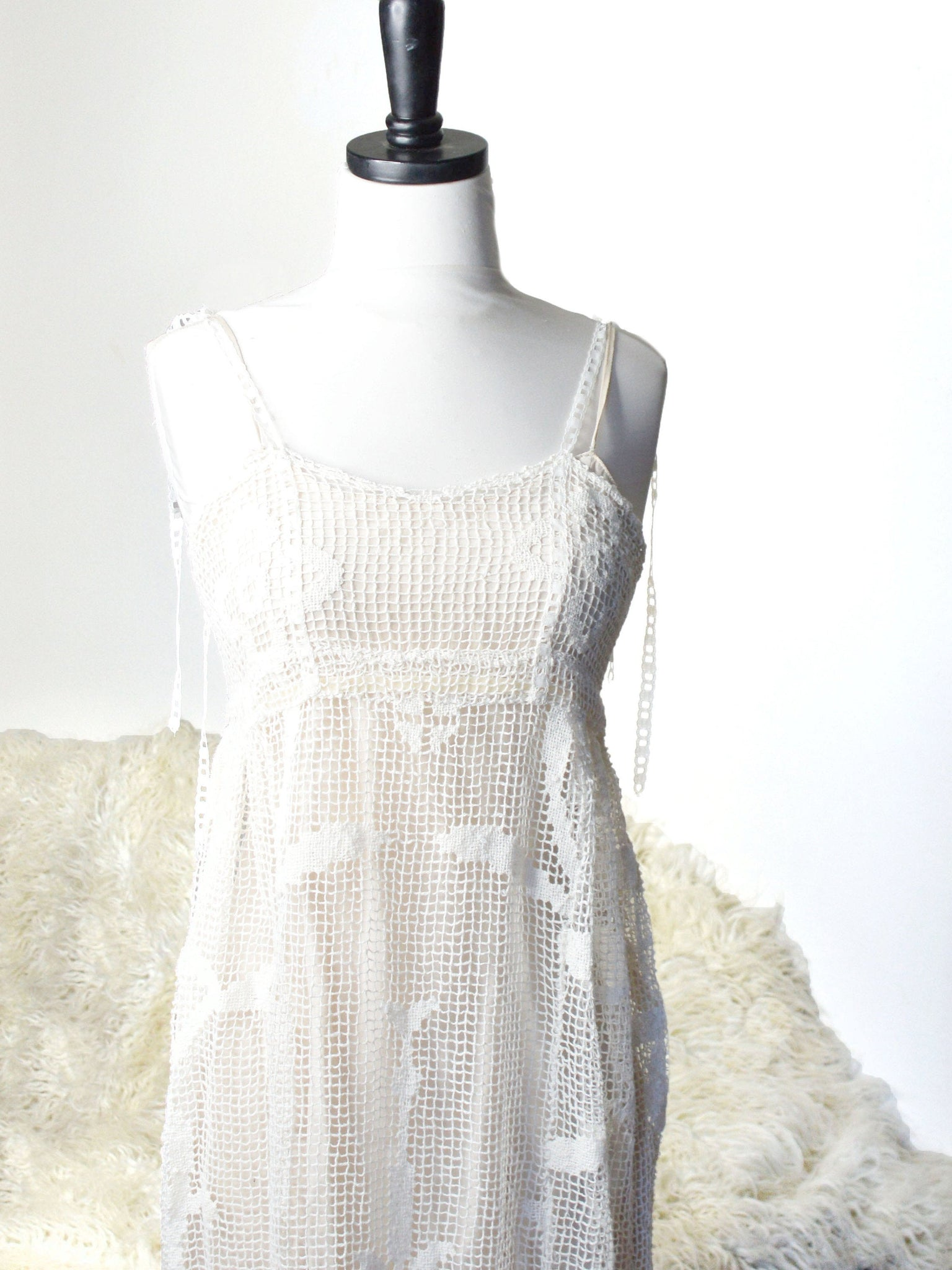 Long white crochet wedding gown.