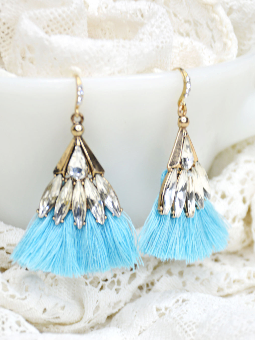 Blue and gold tassel earrings with crystals.