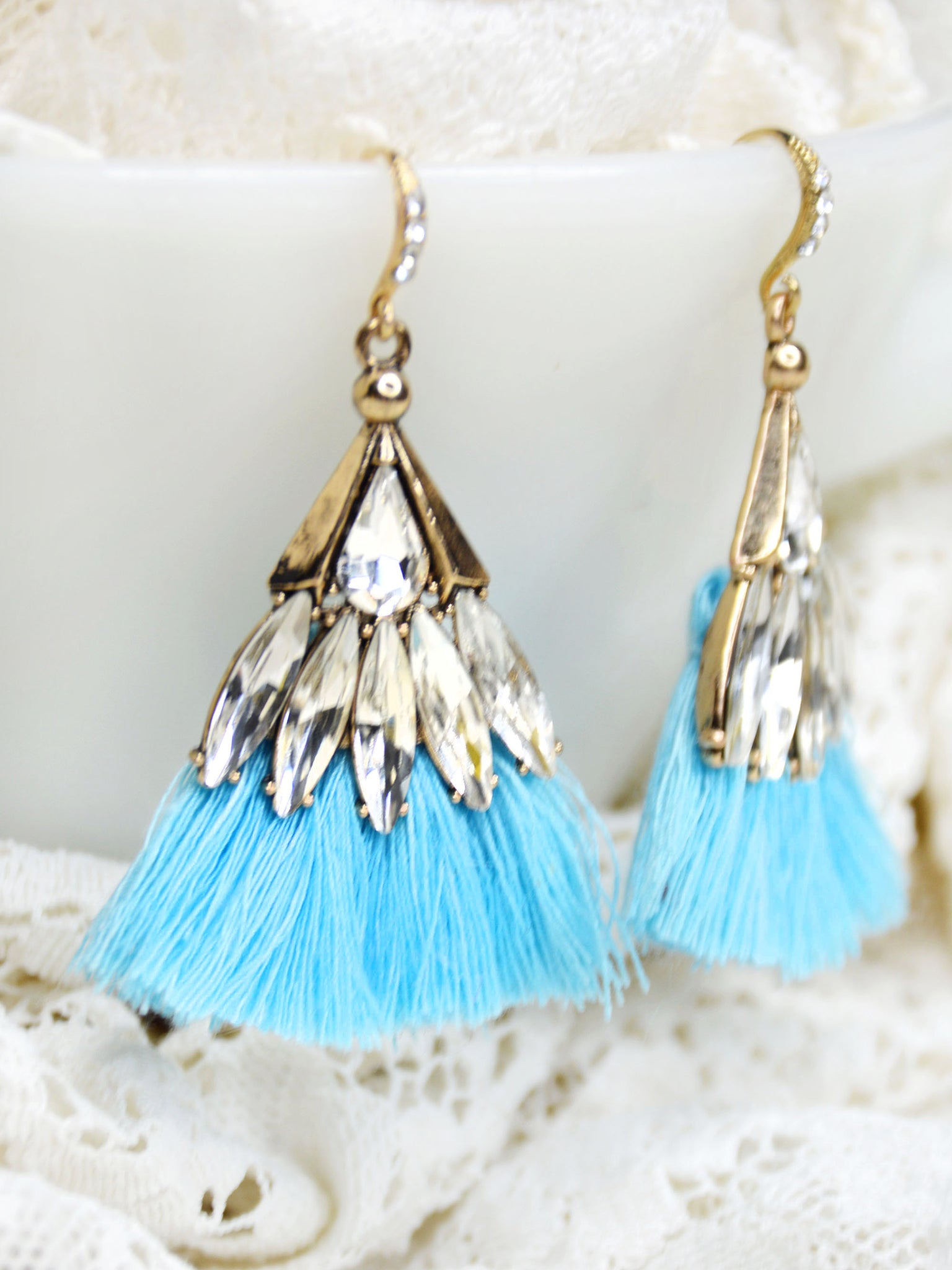 Alternative bohemian blue and gold dangle earrings with crystals.