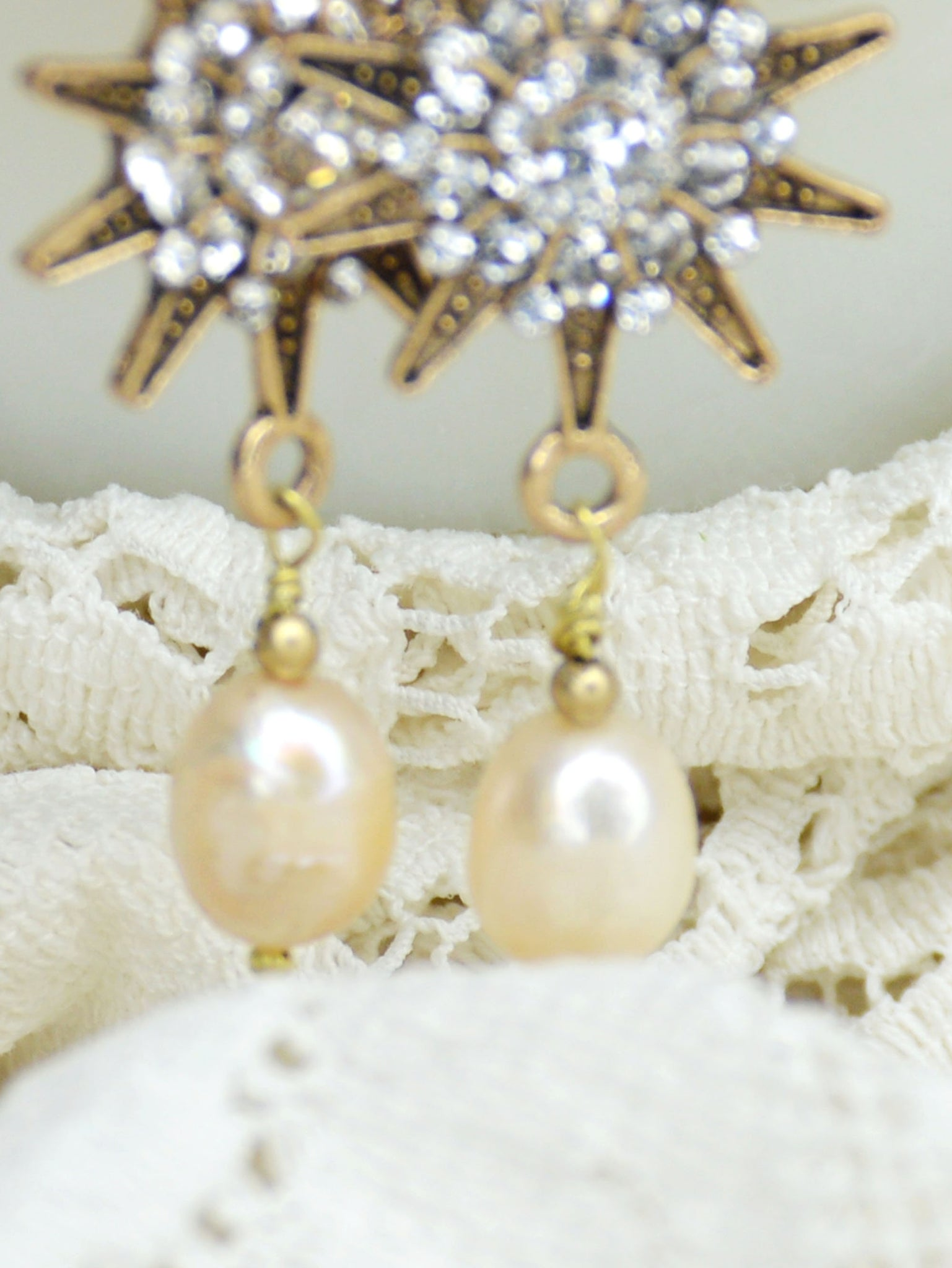 long gold sunburst and pearl earrings