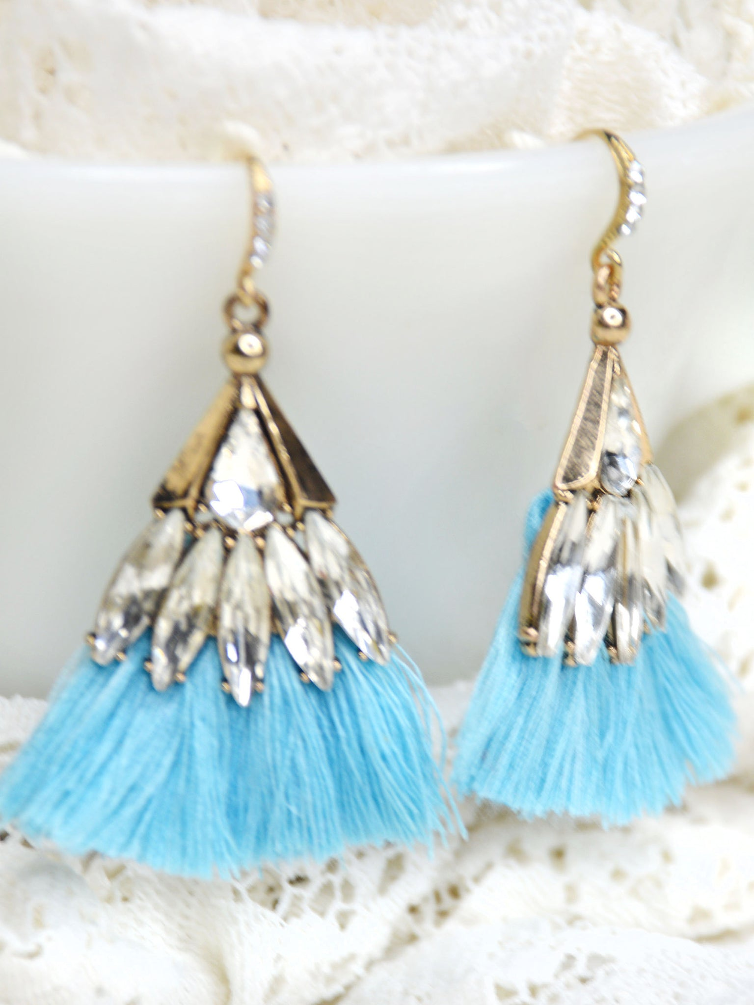 Gold and blue fringe earrings with clear crystals.