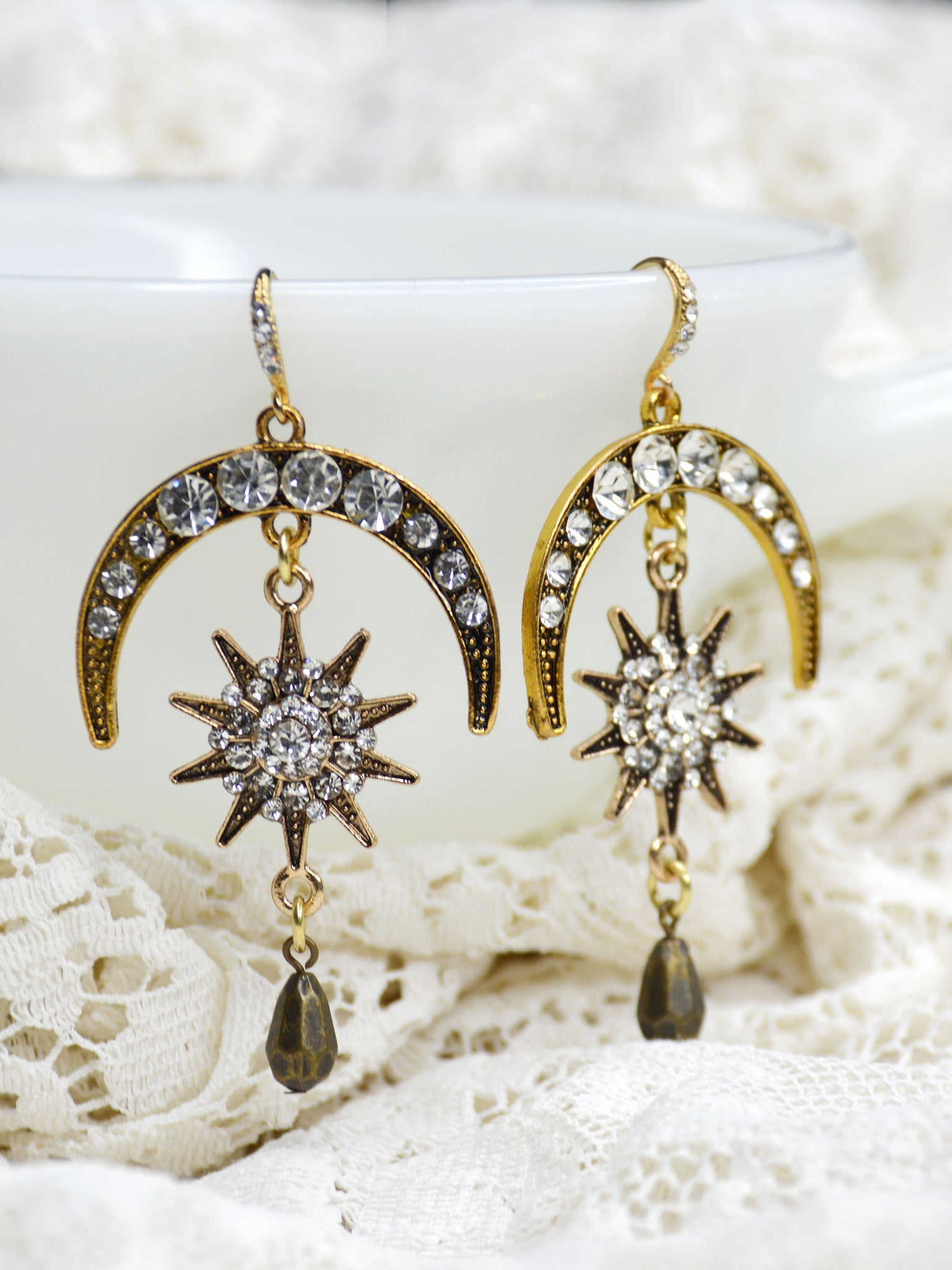 gold crescent drop earrings with sunburst starburst