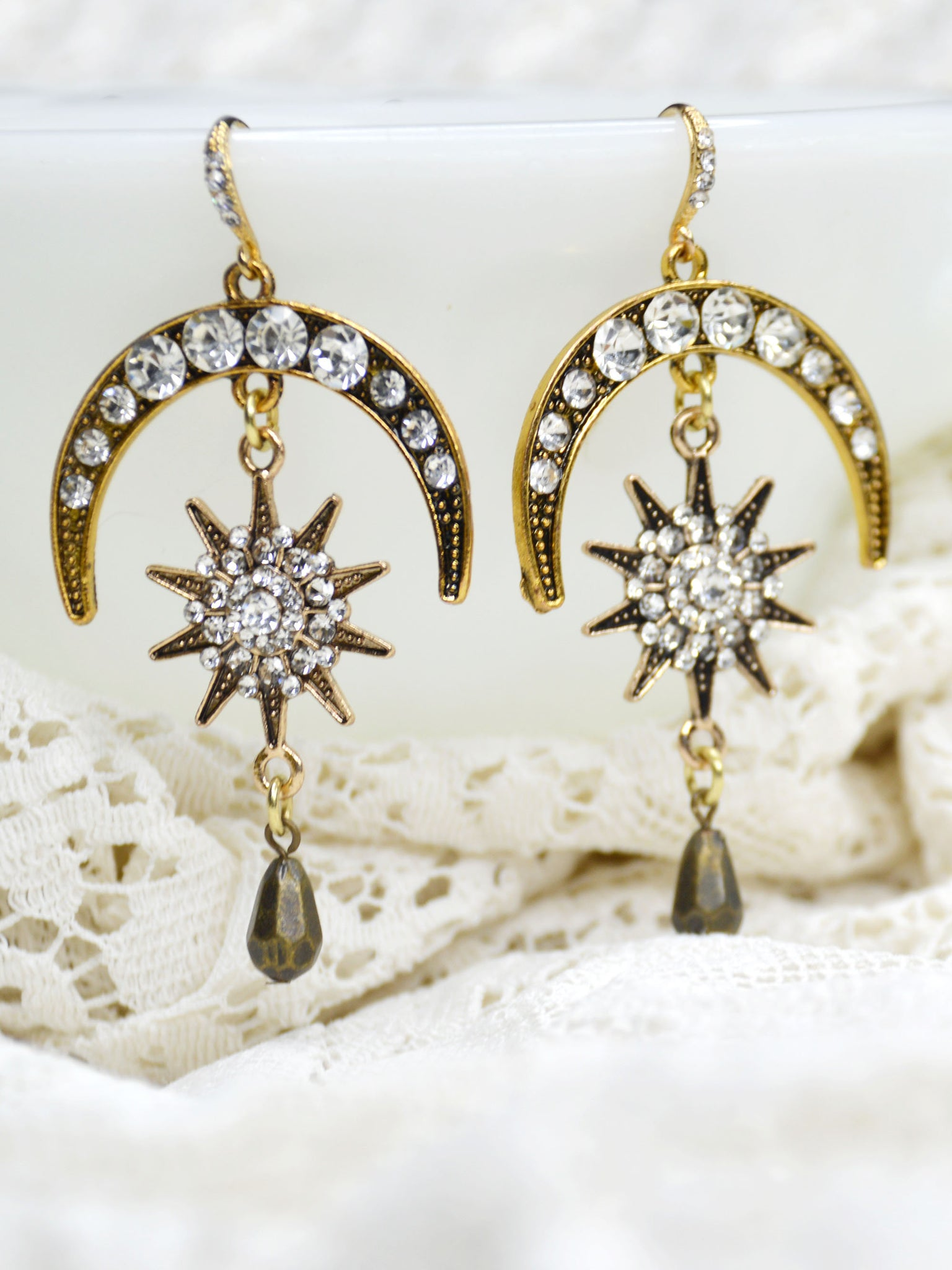 gold and cubic zirconia crystal moon and stars chandelier earrings