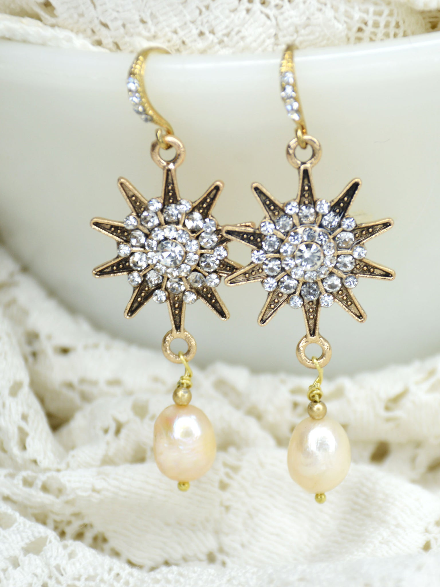 gold, rhinestone, and pearl drop earrings with sunburst