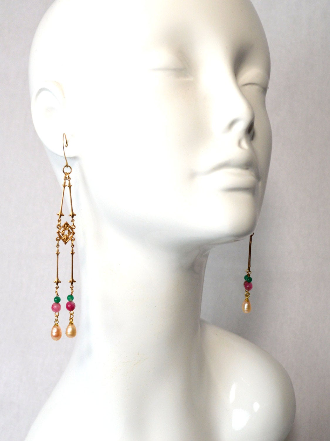 Gold, pink, green, and ivory pearl chandelier earrings.