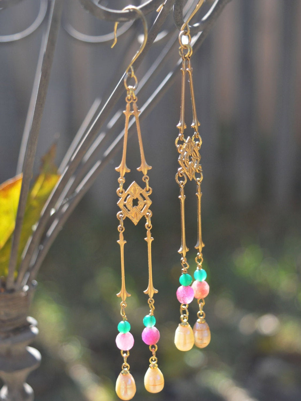Long gold bohemian earrings with pearls.