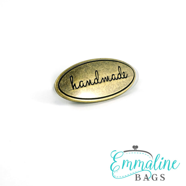 "Metal Bag Label: Oval with ""Handmade"""